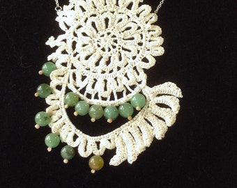 Crochet lace medallion with aventurine beads.