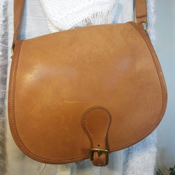 https://www.etsy.com/listing/531771422/rare-vintage-tan-leather-coach-crossbody?ref=shop_home_feat_3
