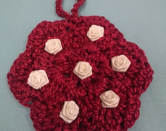 Red flower ornament with white roses