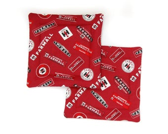 Set of two Farmall Pot Holders: Farmall and IH logos, emblems and signs