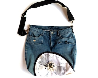 Dark blue denim bag with orange and white appliqué long adjustable strap