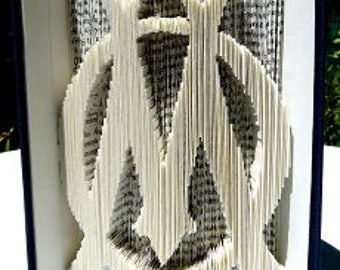 """OM"" 3D book sculpture"