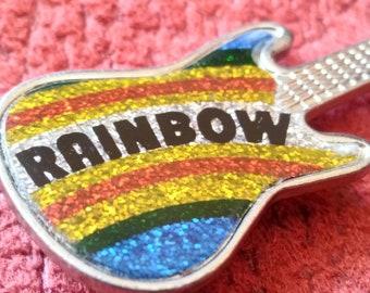 Rainbow !! Vintage 80s guitar pin .