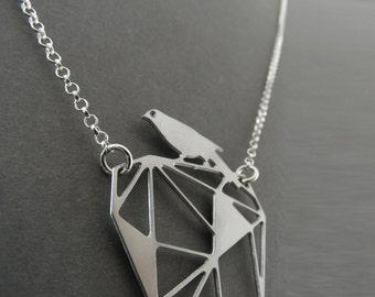 silver bird necklace, bird on a rock, geometric bird necklace, geometric jewelry, silver necklace
