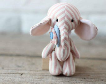 Soft toy pink cotton elephant. Handmade stuffed animal for baby game. Fabric sewn toy elephant is best gifts for baby and woman.