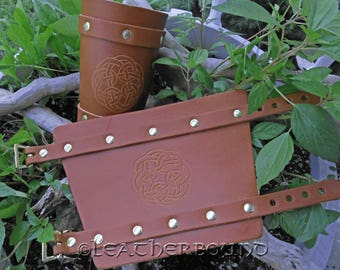 Leather Bracers with hand Carved Celtic Knot image in Chestnut Brown.