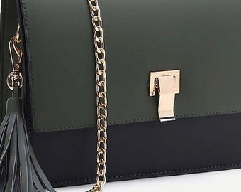 Cross body handbag cut with tassle