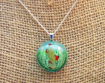 Resin pendant - handpainted ladybugs in a grassy field with a real tuft of grass on a cloudy blue sky background  - Multi-layer  painting