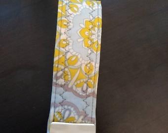 Yellow, light blue, and grey flower design key fob