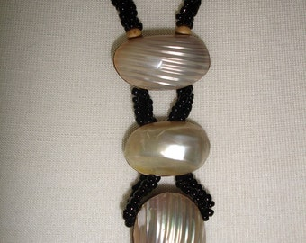 Mother of pearl, wood and black seed beads
