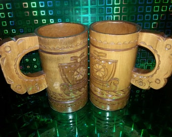 Two antique beer mug. Woodcarving
