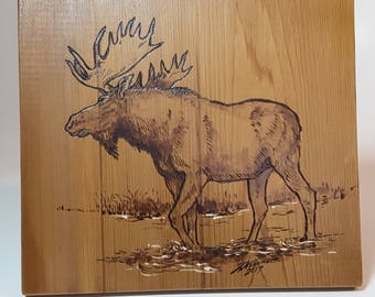 Moose wading, wood burning with painted highlights