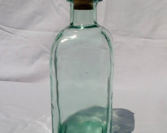 vintage pharmacy or apothecary square bottle with spout and cork