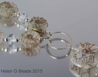 Clear and gold coastal style lampwork and silver necklace from the Jurassic Coast range. Handmade by Helen Gorick