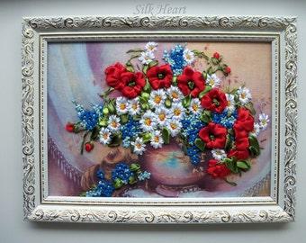 Cornflowers, daisies, poppies in a vase
