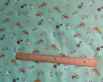Green with Multicolored Tractors Cotton Fabric by the Yard