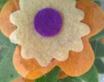 Set of four adhesive felt flowers