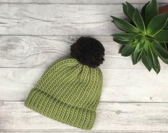 Sage green knitted hat, fashionable knitwear, modern knitwear, bobble hat, snowboarding hat, pom pom hat, winterwear, hipster beanie, skiing