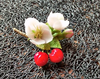 Handmade cherry blossom brooch.  Brooch with a branch of cherry blossoms from a cold porcelain.