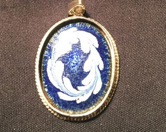 Blue and white enamel sterling silver pendant