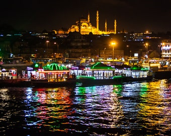 The view of the Süleymaniye Mosque at night as seen from the Galata Bridge, Istanbul, Turkey.