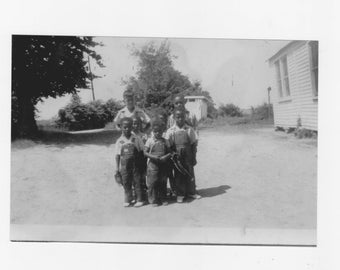 1930s  photograph of 7  African Americans boys on the playground at a one room school house a reprint from original photograph