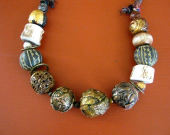 chunky assembled boho necklace of large paper, clay and antler beads