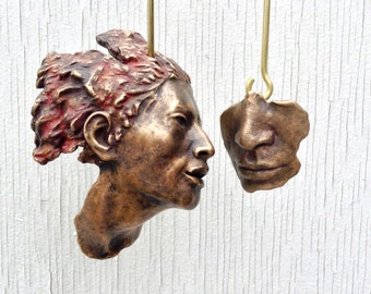 Intimacies: A Face and a Mask, A Mobile Sculpture Cast in Bronze