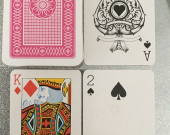 Pink back, Plastic coated playing cards. Plastic boxed.