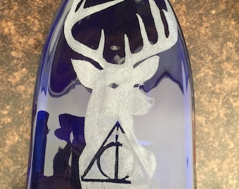 Harry Potter deathly hallow and patronus flattened wine bottle spoonrest or suncatcher.
