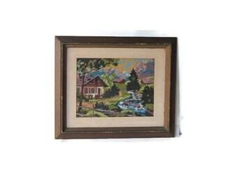Vintage landscape embroidery. Brown wood vintage frame.