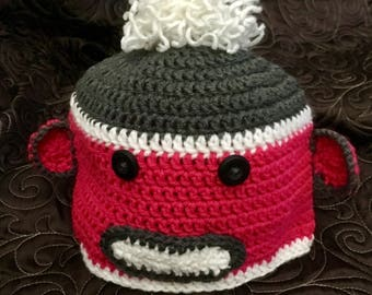Pink and grey monkey hat
