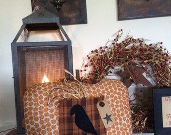 Primitive pumkin pillow/shelf sitter with crow and berries
