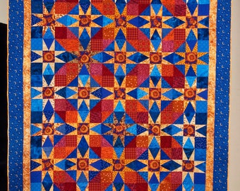 """Quilt -- Gold Stars and Red """"Circles"""" are Set against Cobalt Blue Background"""