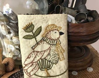 Tweedy Bird needle book - dressed bird with needle and thread