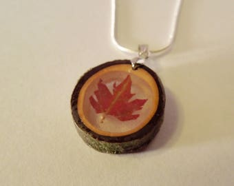 Wooden pendant with a leaf