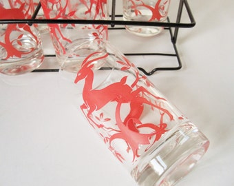 Set of Eight Leaping Gazelle Glasses - Gazelle Leaping Trees - Black Iron Holder With Curls at Top - Mint Condition Flamingo Pink Color