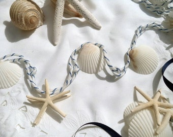 Shell & Starfish Garland - Nautical White and Navy  Quickly decorate any table, shelf, etc. with this easy simple garland for a beachy look.
