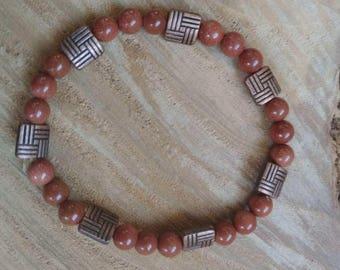 Polished sandstone and copper stretch bracelet