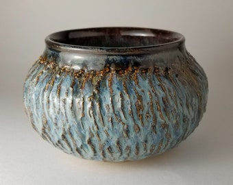 Hand thrown ceramics closed form.