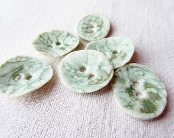 6 buttons in green color glazed porcelain