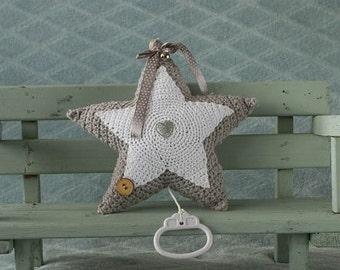 Handmade crochet cuddle toy star with music box.