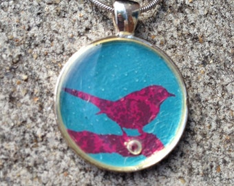 Blue and pink bird with a pearl resin pendant necklace