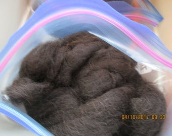 Black with a wisp of Red Alpaca Roving