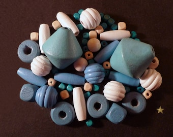 Wooden beads of various shapes of color blue, white