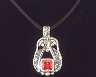 Precious metal clay 960 sterling silver pendant with a 8mm hessonite garnet cz