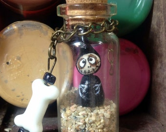 Miniature Grimmy in a bottle with bone bead