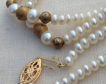 pearl necklace with 14k lock and goldtone balls. circa 1970's