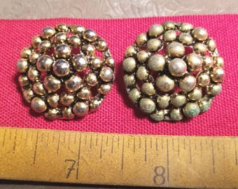 Two knobby gold domed buttons