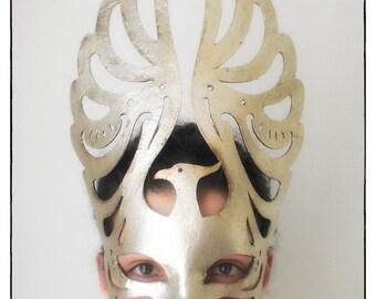 Phoenix. Handmade paper maché Mask in silver foil. La Fenice Theater. Venice